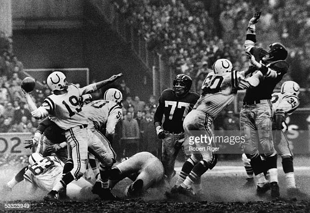 American quarterback Johnny Unitas of the Baltimore Colts is about to throw a pass during a play in sudden death overtime of the NFL Championship...