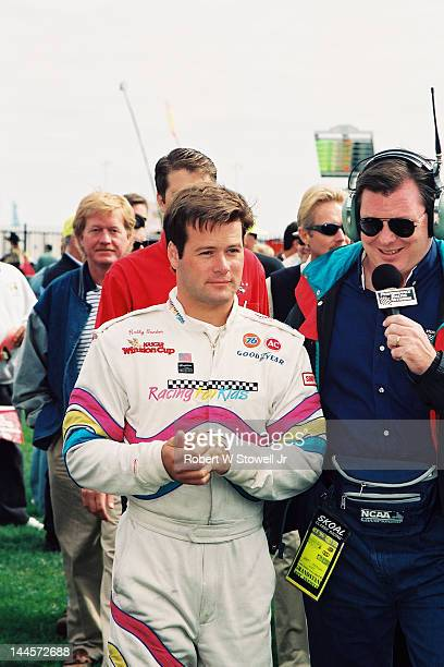 American race car driver Robby Gordon gives an interview before the Winston Cup Race at the Charlotte Motor Speedway Charlotte North Carolina 1997
