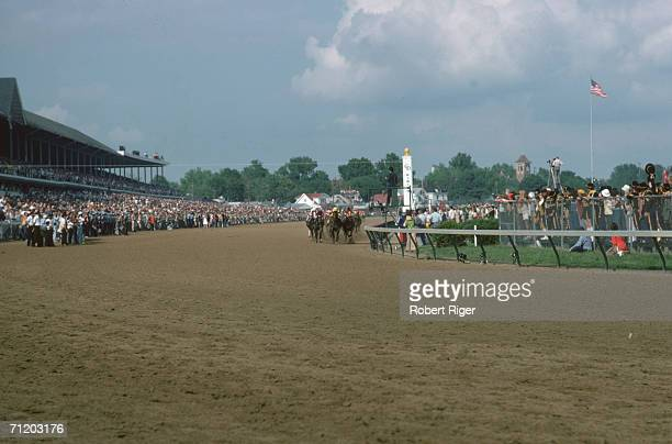 American racehorse Seattle Slew ridden by French jockey Jean Cruguet and competitors come down the home stretch during the Kentucky Derby Louisville...