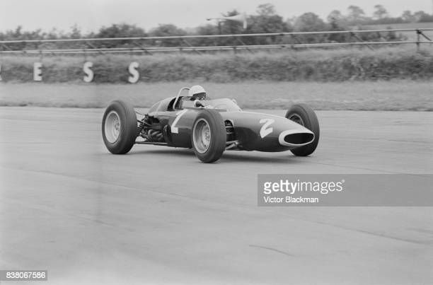American racing car driver Richie Ginther drives team British Racing Motors, BRM P578, during the British Grand Prix at Silverstone, UK, 20th July...