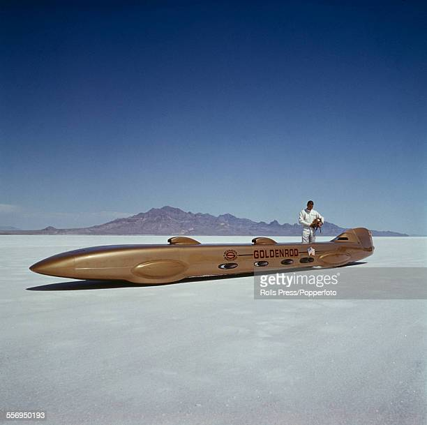 American racing driver Bob Summers stands beside his streamlined car 'Goldenrod' before setting the wheeldriven land speed record of 409 mph at...