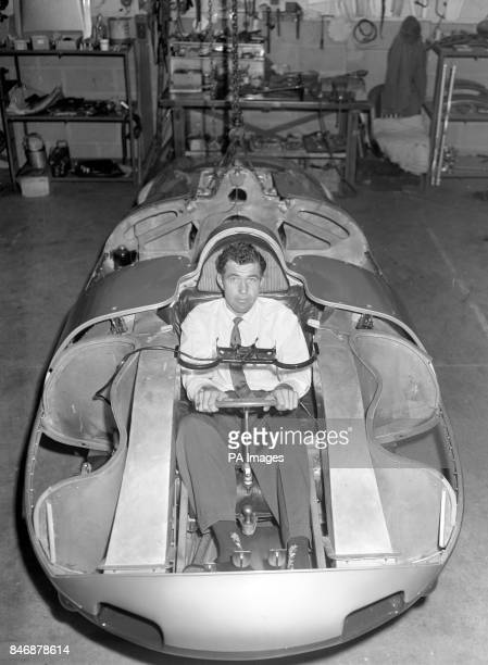 American racing driver Carroll Shelby fits into a specially built Austin Healey which he will drive in a record attempt on Bonneville Salt Flats in...