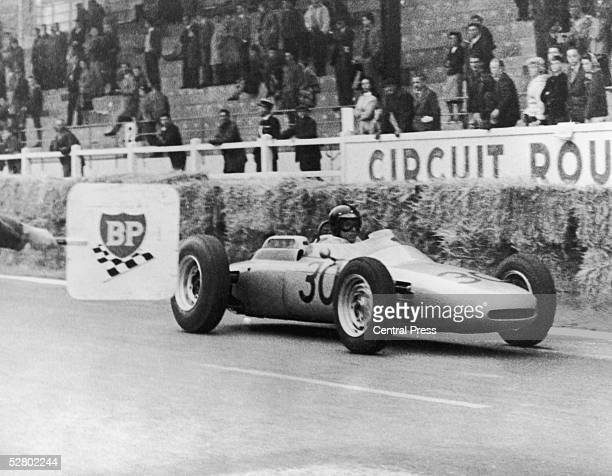American racing driver Dan Guerney wins his first Formula 1 race driving a Porsche 804 in the French Grand Prix at Rouen 8th July 1962