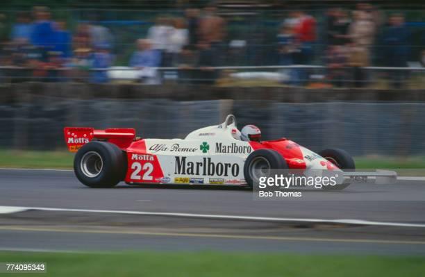 American racing driver Mario Andretti drives the Marlboro Team Alfa Romeo Alfa Romeo 179C Alfa Romeo V12 in the 1981 British Grand Prix at...