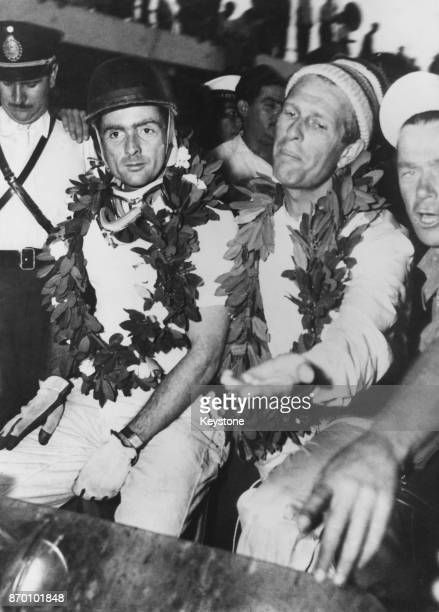 American racing driver Phil Hill and teammate Peter Collins after their victory in the 1000km Buenos Aires race in Argentina 26th January 1958