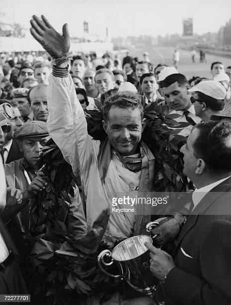 American racing driver Phil Hill wins the Italian Grand Prix at Monza, 10th September 1961. His teammate Wolfgang von Trips had crashed his car...