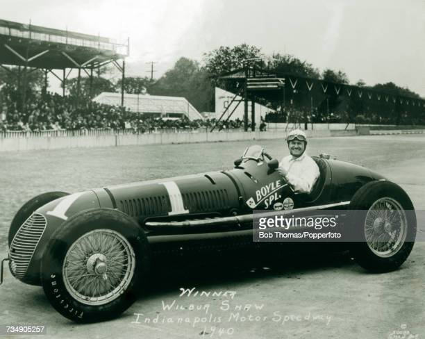 American racing driver Wilbur Shaw pictured in the driving seat of his Maserati 8CTF racing car after finishing in first place to win the 28th...