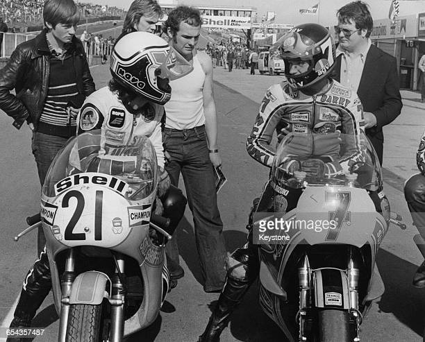 American racing motorcyclist Steve Baker talks to his British rival Barry Sheene during round 1 of the Transatlantic Trophy competition between...