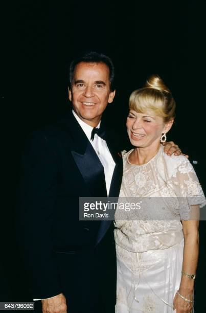 American radio and television personality Dick Clark poses for a portrait with his wife Kari Clark circa 1993 in Los Angeles California