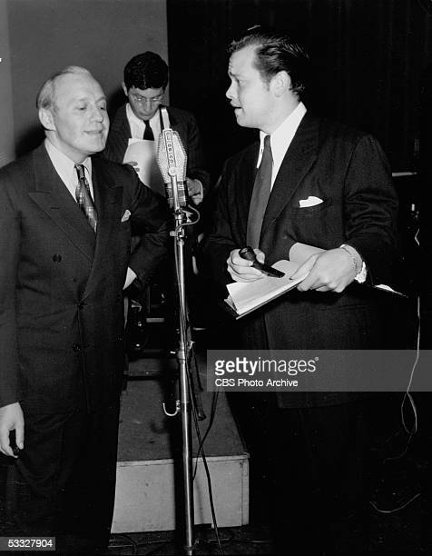 American radio director actor and playwright Orson Welles complains exasperatedly to comedian Jack Benny during rehearsal of 'June Moon' at the KNX...