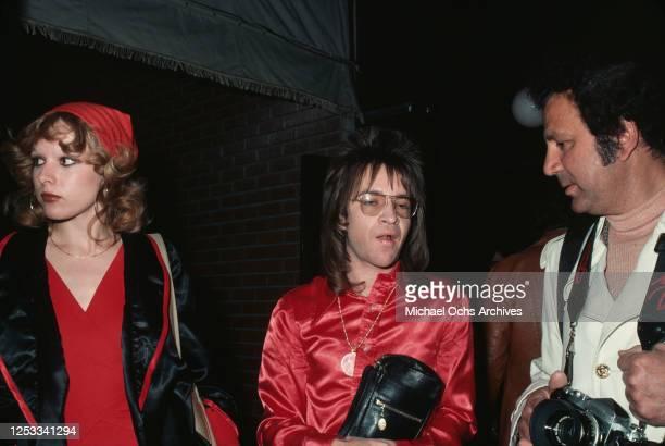 American radio disc jockey Rodney Bingenheimer and photographer Ron Galella , February 1977.