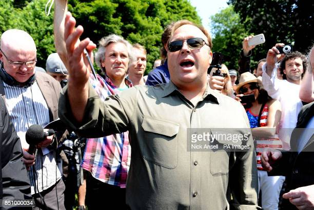 American radio host author conspiracy theorist and documentary filmmaker Alex Jones speaks to the media outside the Grove Hotel in Watford where The...