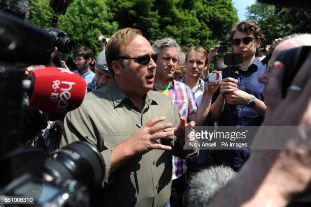 American radio host author conspiracy theorist and documentary filmmaker Alex Jones speaks to the media and his followers as he arrives at the Grove...