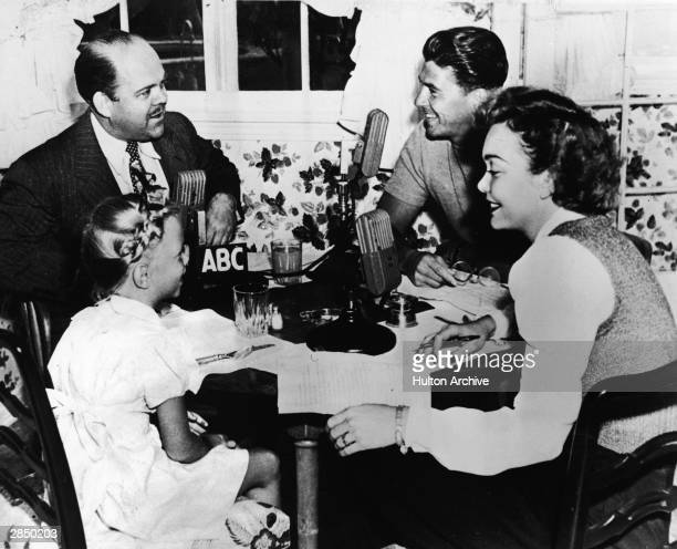 American radio personality Ted Malone eats breakfast with American actor and politician Ronald Reagan and his family American actor Jane Wyman and...