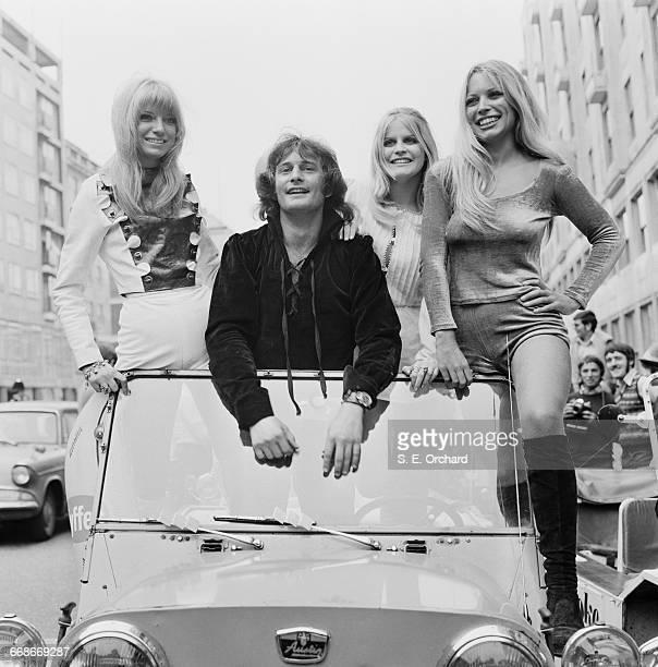 American radio presenter Emperor Rosko poses with Brenda Puddock Sue Bond and Sue Shaw in a an Austin Mini Moke UK 21st August 1971