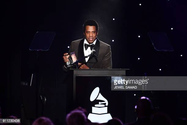 American rapper and businessman Shawn Corey Carter known professionally as JAYZ acknowledges his Industry Icon award during the traditionnal Clive...