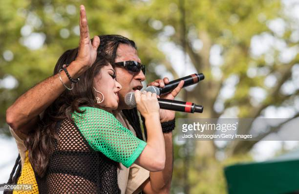 American rapper Destiny Torres and British singer reggae DJ Apache Indian perform at Central Park SummerStage during the Basement Bhangra 20th...