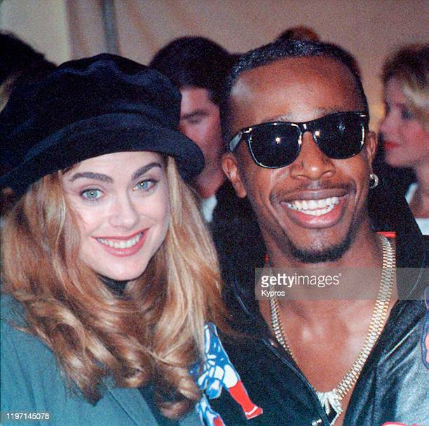 American rapper MC Hammer with model and actress Kathy Ireland at the NFL Experience Kids' Day for Underprivileged Children at the Rose Bowl Stadium...