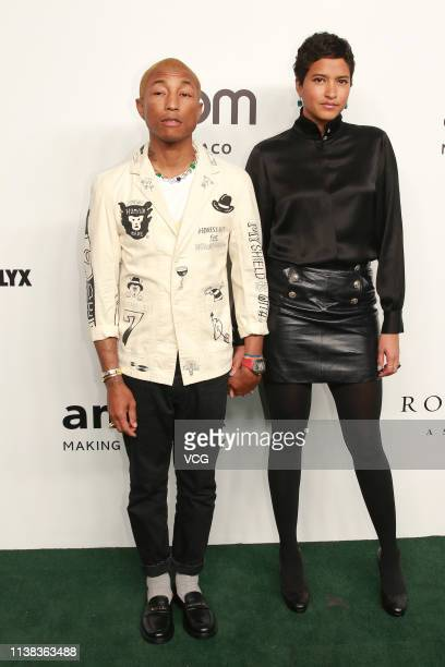 American rapper Pharrell Williams and his wife Helen Lasichanh attend the amfAR Gala Hong Kong 2019 at the Rosewood Hong Kong on March 25 2019 in...