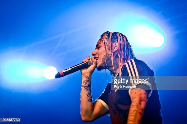 American rapper Tekashi 6ix9ine performs live on stage during a concert at the Huxleys on July 7 2018 in Berlin Germany