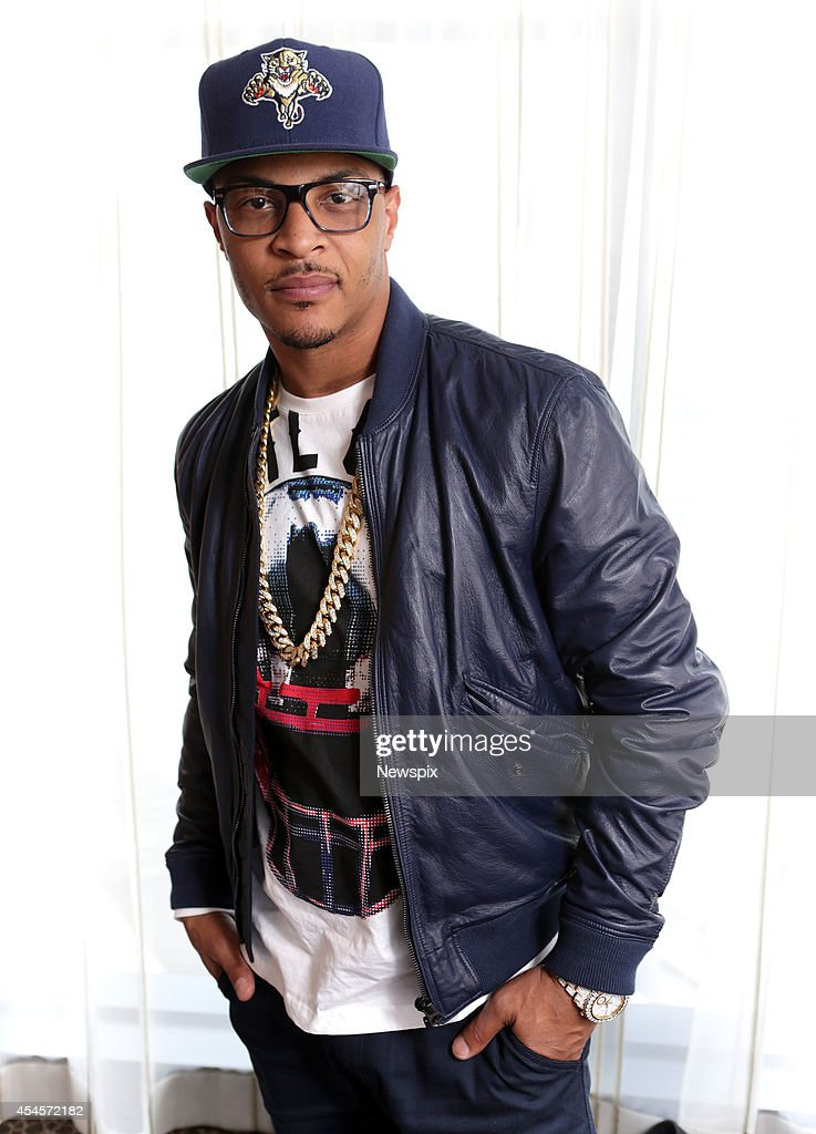 American rapper T.I. poses during a photo shoot at the Darling Hotel on September 3, 2014 in Sydney, Australia. T.I. is in Australia to promote his new album, 'Paperwork: The Motion Picture'.