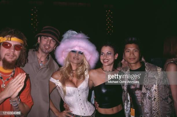 American rapper TiLo American drummer Tommy Lee American actress Pamela Anderson American actress Natalie Raitano and VietnameseAmerican actor...