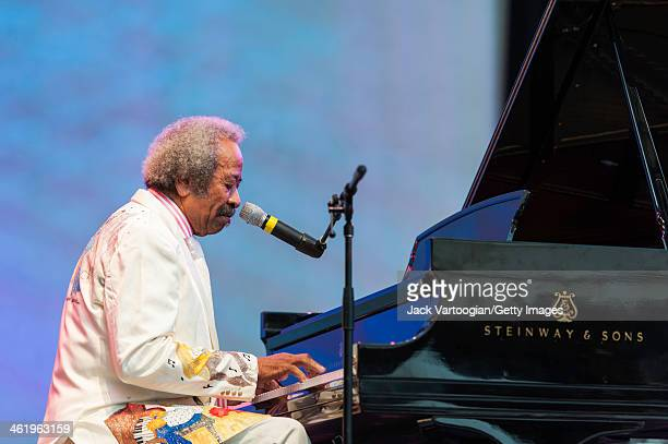 American RB and Blues composer musician arranger and record producer Allen Toussaint sings and plays piano during a solo set at the 30th Annual Roots...