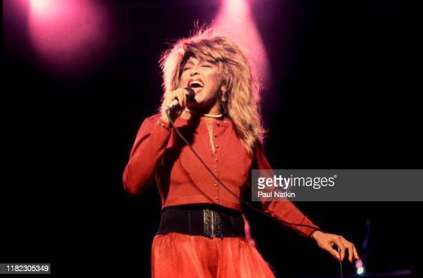 American RB and Pop singer Tina Turner performs onstage at the Poplar Creek Music Theater Hoffman Estates Illinois September 12 1987