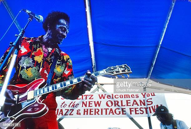 American R&B and Rock musician Chuck Berry performs onstage at the New Orleans Jazz & Heritage Festival, May 1981.