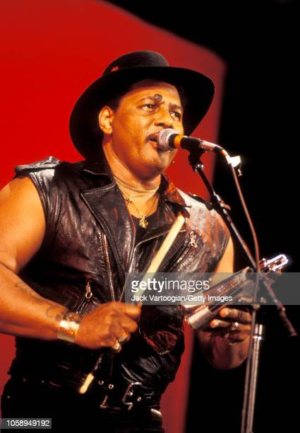 American RB and Soul musician Aaron Neville plays cowbell as he performs with the Neville Brothers at a benefit for and at Central Park SummerStage...