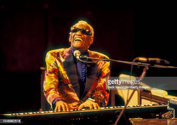 American RB and Soul musician and band leader Ray Charles plays piano as he performs during a JVC Jazz Festival concert at Avery Fisher Hall at...