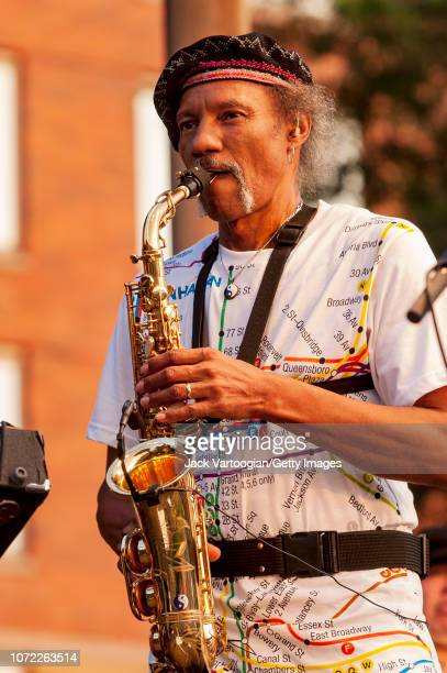 American R&B, Funk, and Jazz musician Charles Neville plays alto saxophone as he performs with the Neville Brothers at the 2004 Hudson River...