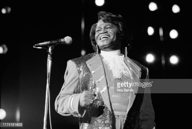 American R&B, Funk, and Soul singer James Brown smiles as he performs onstage at the Paramount, New York, New York, February 28, 1992.