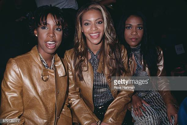 American RB girl group Destiny's Child attends the Betsey Johnson Playboy Bunnies Spring 2001 fashion show New York City USA circa 2000 LR Kelly...