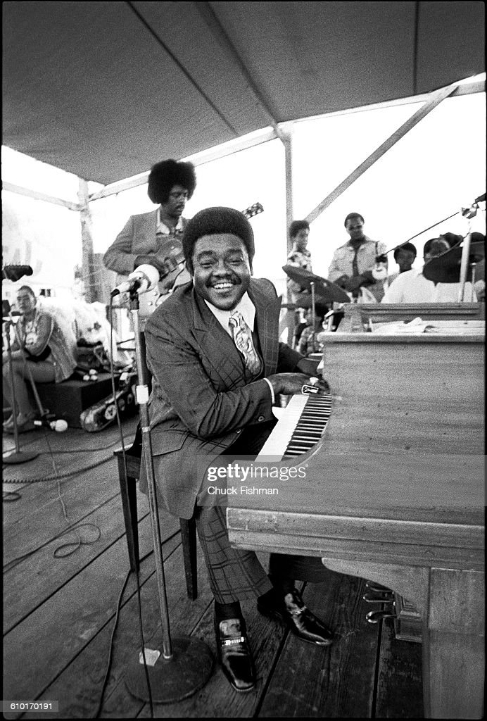 American R&B musician Fats Domino (born Antoine Domino Jr) plays piano as he performs onstage during the New Orleans Jazz & Heritage Festival at the Fair Grounds Race Course, New Orleans, Louisiana, April 1977.