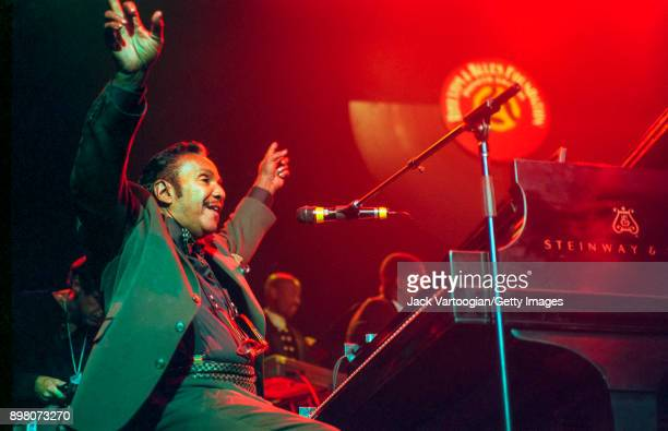 American RB musician Huey 'Piano' Smith plays piano as he performs during the Rhythm Blues Foundation Pioneer Awards at the Hammerstein Ballroom New...