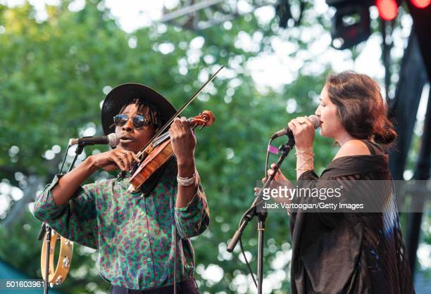 American RB musician Marques Toliver and guest vocalist Haley Dekle sing together during a performance at Central Park SummerStage New York New York...