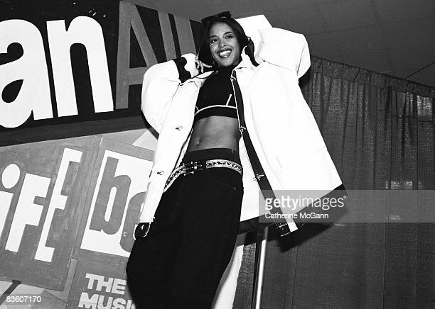 American RB singer Aaliyah aka Aaliyah Dana Houghton poses for a photo backstage at Madison Square Garden for Lifebeat's Urban Aid benefit concert on...