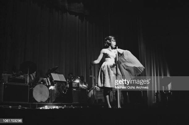 American RB singer Sugar Pie DeSanto performs at the Apollo Theater in New York City 1964