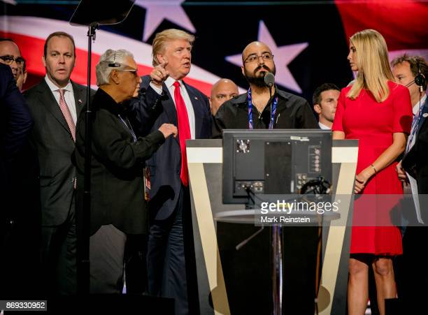 American real estate developer and presidential candidate Donald Trump and his daughter Ivanka Trump stand on either side of an unidentified...
