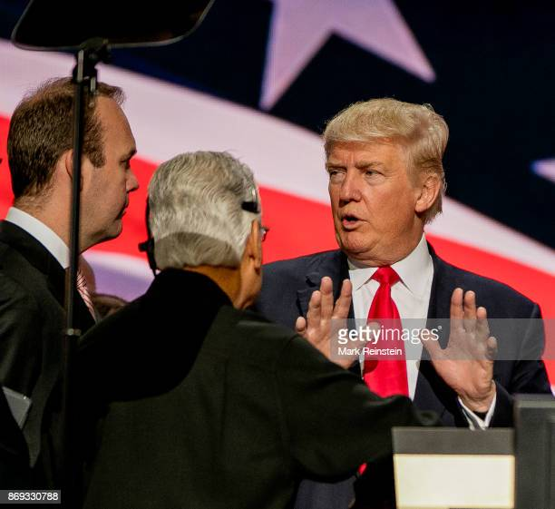 American real estate developer and presidential candidate Donald Trump talks with campaign advisor Rick Gates on stage during the sound check on the...