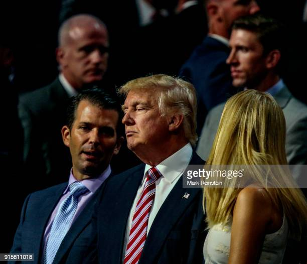 American real estate developer and presidential candidate Donald Trump stands with two of his children Donald Jr and Ivanka Trump as they attend the...