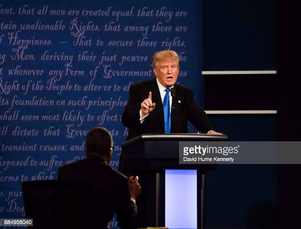 American real estate developer and presidential candidate Donald Trump holds up a finger during the first US presidential debate held at Hofstra...