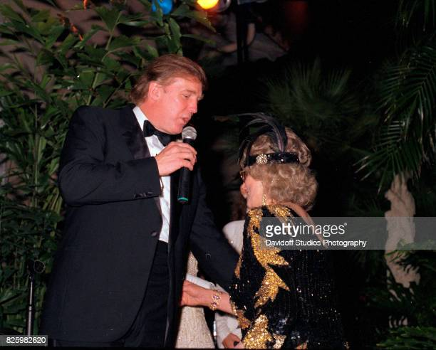 American real estate developer Donald Trump and former competative swimmer Marjorie Post Dye stand onstage during a 'roaring 20's' party at the...