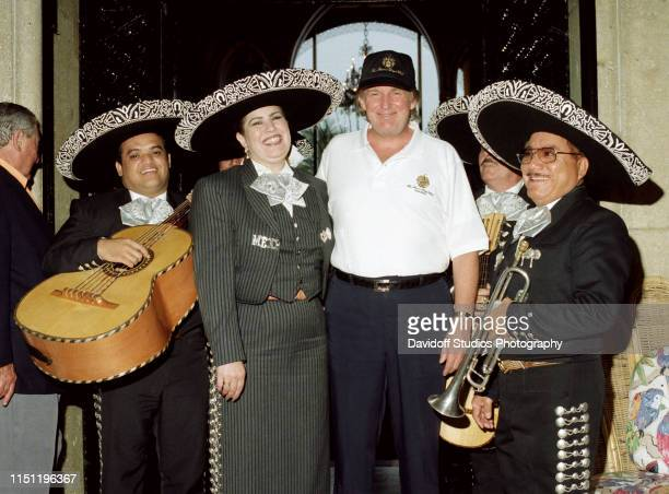 American real estate developer Donald Trump poses with an unidentified mariachi band during a brunch at the MaraLago estate Palm Beach Florida March...