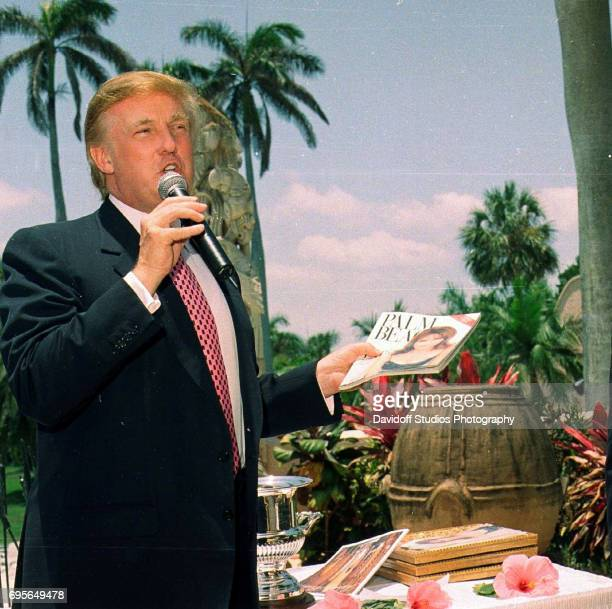 American real estate developer Donald Trump speaks into a microphone during a Mother's Day event at the MaraLago estate Palm Beach Florida May 14...