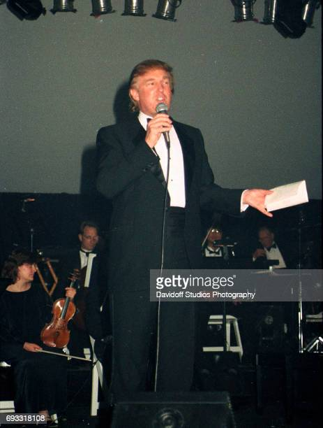 American real estate developer Donald Trump speaks onstage at the MaraLago Club Palm Beach Florida December 13 1997 Unidentified musicians are...