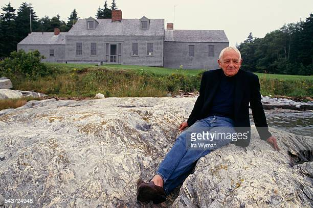 American Realist painter and Regionalist artist Andrew Wyeth in front of his home in Cushing