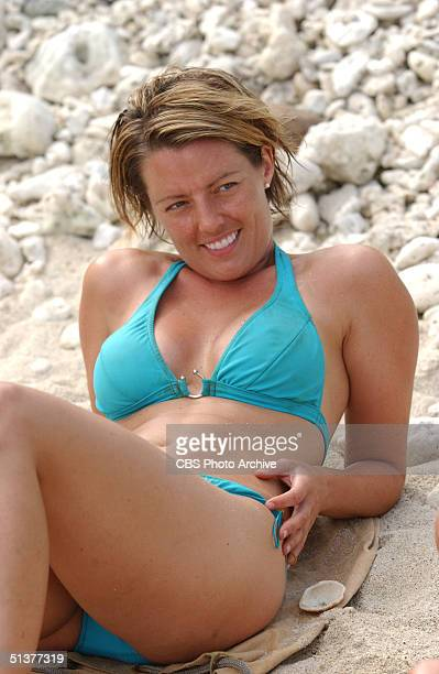American reality show participant and ersatz castaway Ami Cusack reclines on the pebbly beach in a bikini during the second episode of 'SURVIVOR...