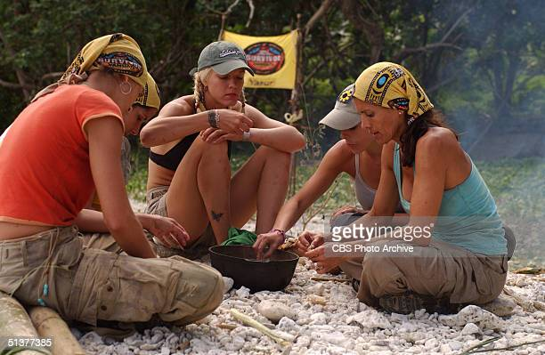 American reality show participants and simulated castaways Mia Galeotalanza Julie Berry Dolly Neely Eliza Orlins and Lisa Keiffer sit on the ground...